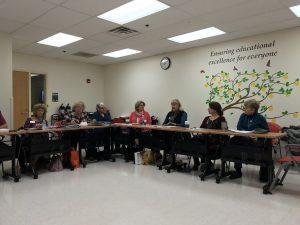 Exchange Club members sitting at meeting tables
