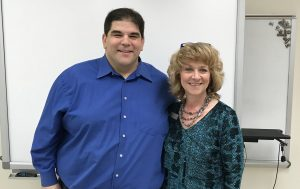 Pastor Gary Ricci poses with Exchange Club President, Sherry Ridge