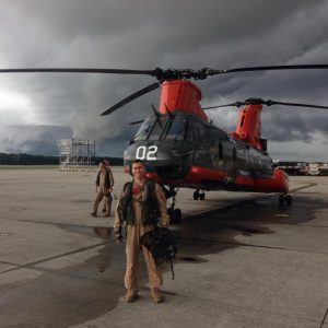 Marine, Wyatt Weber standing in front of helicopter